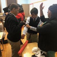 Sign of the times: Cristo Rey students learn to stop trauma victims' bleeding