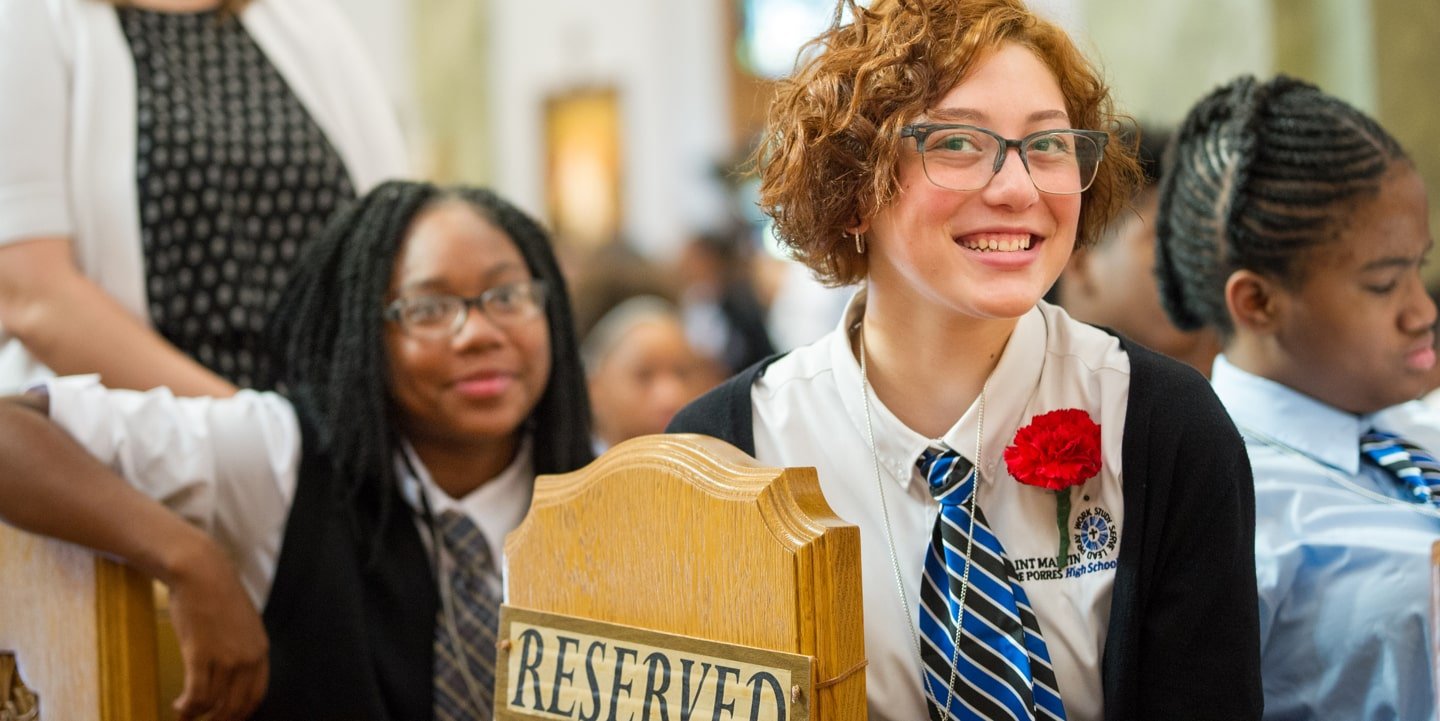 Girl smiling at Mass